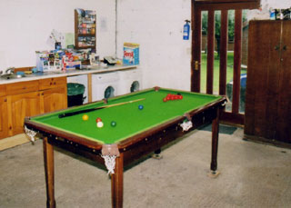 The pool table in the Laundry Room
